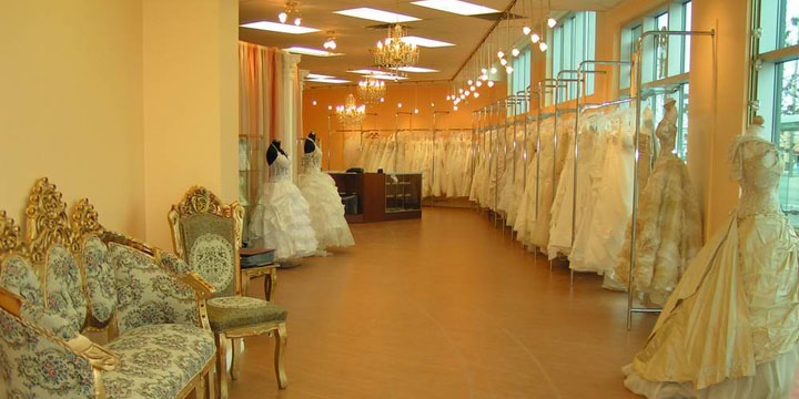 Gerald barja takes picture of a bridal shop interior.